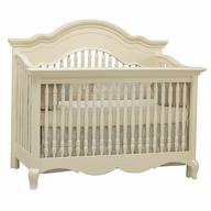beige baby crib
